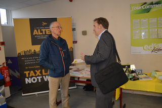 Vice Chair Tony Vickers (left) talks to a delegate